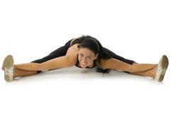 Brunette strecthing her legs royalty free stock photo