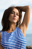 Brunette in striped shirt Royalty Free Stock Images
