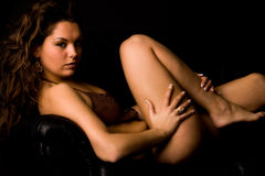 Brunette is stroking her leg Royalty Free Stock Photos