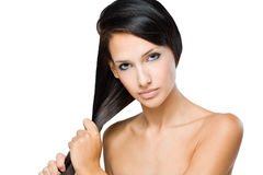 Brunette with strong healthy hair. Royalty Free Stock Photos