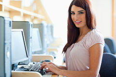 Brunette student posing with a computer Royalty Free Stock Images