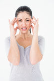 Brunette suffering from migraine Royalty Free Stock Images