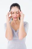 Brunette suffering from migraine Stock Photos