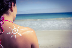 Brunette with sun tan lotion on her shoulder Royalty Free Stock Images