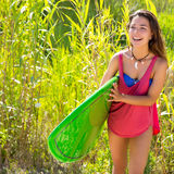 Brunette surfer girl walking in the jungle Royalty Free Stock Image