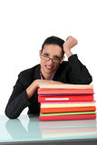 Brunette surrounded by paperwork Royalty Free Stock Photography
