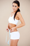 Brunette sweety measuring her waist Stock Photo