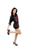 Brunette taking off shoes. Full length of a beautiful brunette taking off her shoes Royalty Free Stock Image