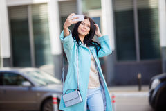 Brunette taking pictures in spring Stock Photo