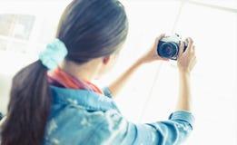 Brunette taking a selfie Stock Photography