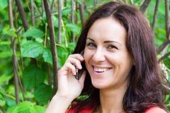 Brunette talking by cellular Stock Images
