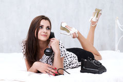 Brunette talking on the retro phone Royalty Free Stock Photos