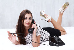 Brunette talking on the retro phone Royalty Free Stock Photography