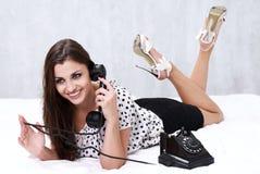 Brunette talking on the retro phone Stock Photo