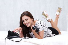 Brunette talking on the retro phone Stock Photos