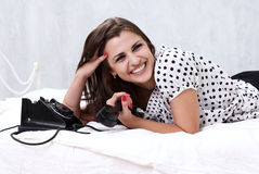 Brunette talking on the retro phone Stock Images