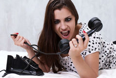 Brunette talking on the retro phone Stock Image