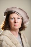 Brunette in taupe hat and fur stole Royalty Free Stock Photography