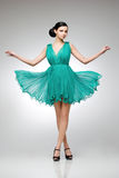 Brunette in teal dress Stock Photography