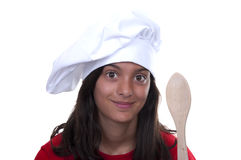 Brunette teen girl chef hat. On white background Stock Photos