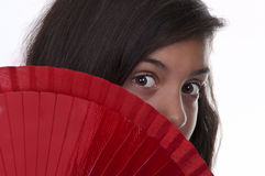 Brunette teen girl with fan Stock Photo