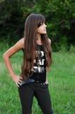 Brunette teen girl on nature Stock Images