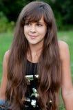 Brunette teen girl on nature. Brunette teen girl on the nature Stock Image