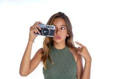 Brunette teen girl vintage photo camera Royalty Free Stock Images