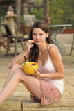 Brunette Teen With Healthy Snack Stock Images