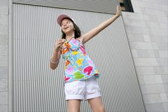 Brunette teen little girl dancing mp3 Royalty Free Stock Photography