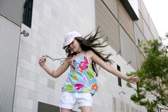 Brunette teen little girl dancing mp3 Stock Photos
