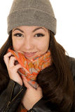 Brunette teen model snuggling her hat and beanie. Brunette teen model snuggling her scarf wearing a hat and beanie Stock Photo