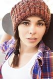 Brunette teenage girl in hipster outfit jeans shorts, keds, pla stock photo