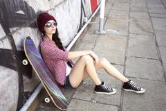Brunette teenage girl in hipster outfit jeans shorts, keds, pla stock images