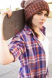 Brunette teenage girl in hipster outfit jeans shorts, keds, pla royalty free stock photos