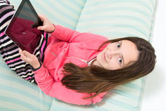 Brunette Teenage Girl Working On A Table PC Royalty Free Stock Photos