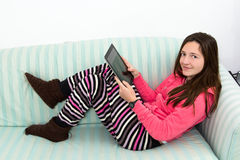 Brunette Teenage Girl Working On A Table PC Royalty Free Stock Photography