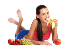 Brunette teenager loves healthy fruits Stock Photography