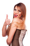 Brunette with thumbs up Stock Images