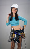 Brunette with Toolbelt of Feminine Items (4) Stock Photography