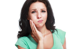 Brunette with a toothache Stock Photography