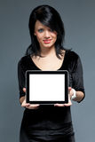 Brunette and touch pad device with blank screen Stock Photos