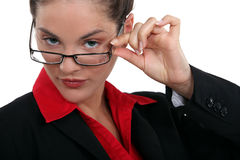 Brunette touching glasses Stock Photo