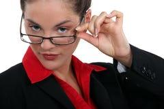 Brunette touching glasses Stock Photo