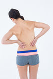 Brunette touching her painful back Stock Images