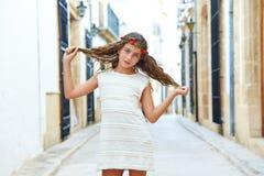 Brunette tourist kid girl in mediterranean town Stock Photos
