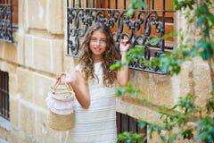 Brunette tourist kid girl in mediterranean white town Stock Images