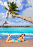 Brunette tourist lying in beach sand tanning happy Royalty Free Stock Images