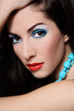 Brunette with turquoise beads Royalty Free Stock Image