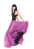 Brunette twirling in her  color dress. Beautiful asian woman twirling in her fashionable purple color dress Stock Photos